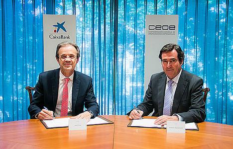 Jordi Gual, Presidente de CaixaBank, y Antonio Garamendi presidente de la Confederación Española de Organizaciones Empresariales (CEOE).