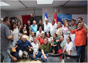 El Excmo. Sr. Embajador de Nicaragua en el centro con los participantes al acto.